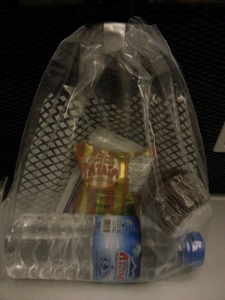 ANA Yangon-Narita route snack sack , and a bottle of water