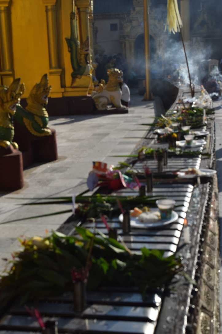 Offerings and fragrance smoking incenses to the Buddhas by the local visitors